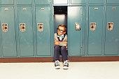 Young Boy Nerd is Happy at his Locker