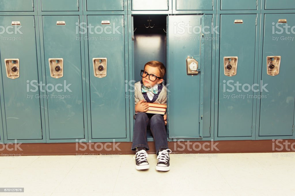 Young Boy Nerd is Happy at his Locker stock photo