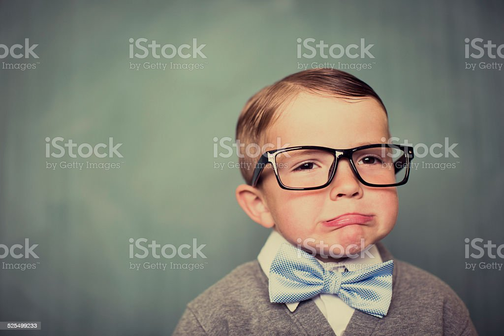 Young Boy Nerd with Glasses Making a Sad Face stock photo