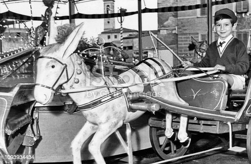 Young boy on a carousel in 1963