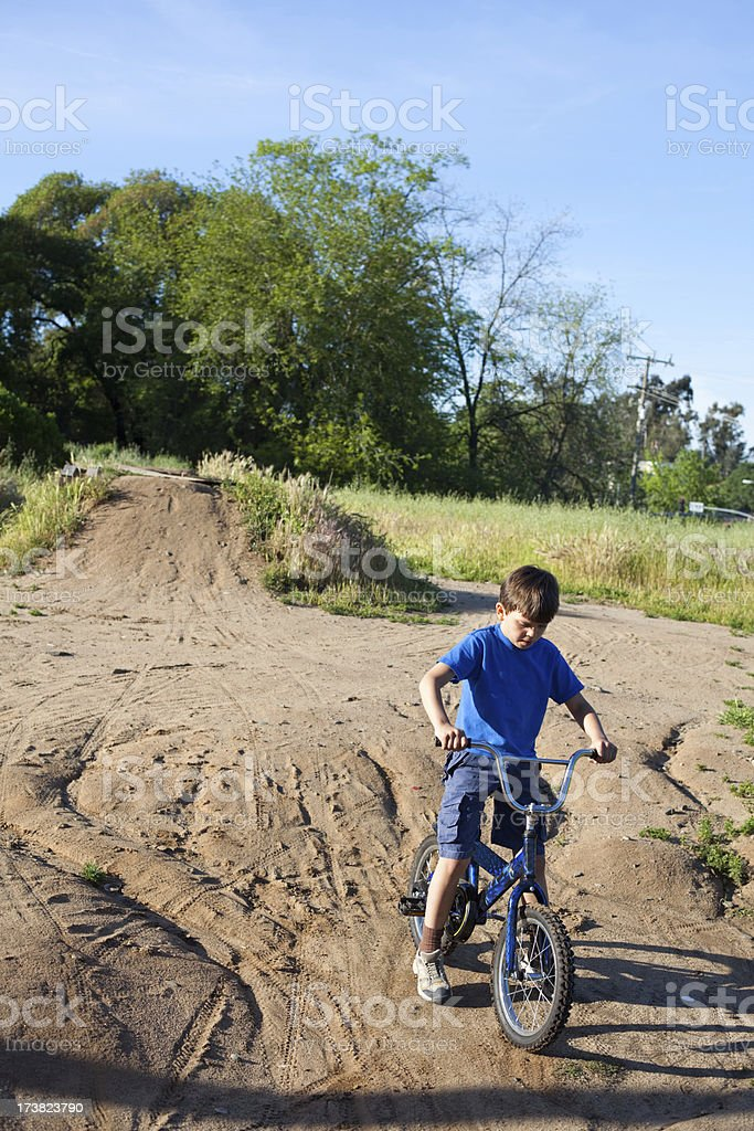 Young boy on a dirt bike stock photo