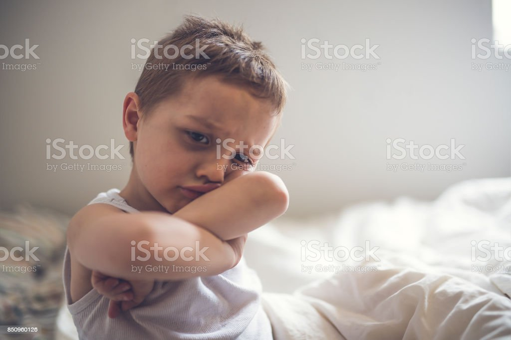 Young Boy on bed stock photo
