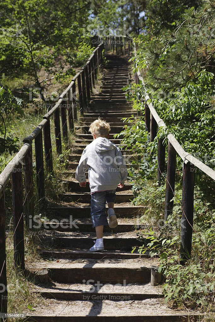 Young Boy On Endless Steps stock photo