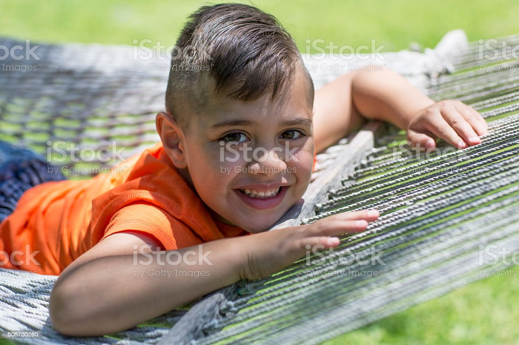 Young boy on hammock stock photo
