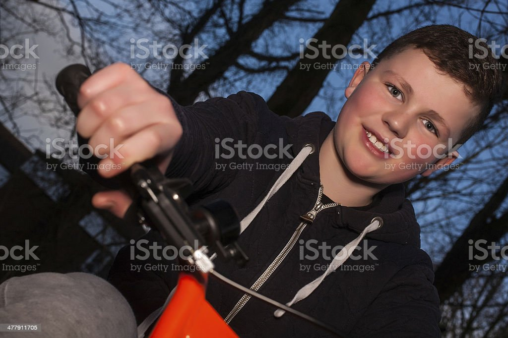 Young boy on his BMX bike stock photo