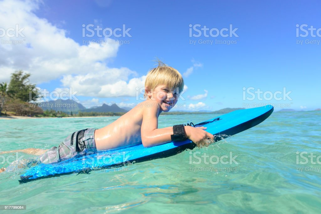 Young Boy On His Boogie Board In Hawaii stock photo