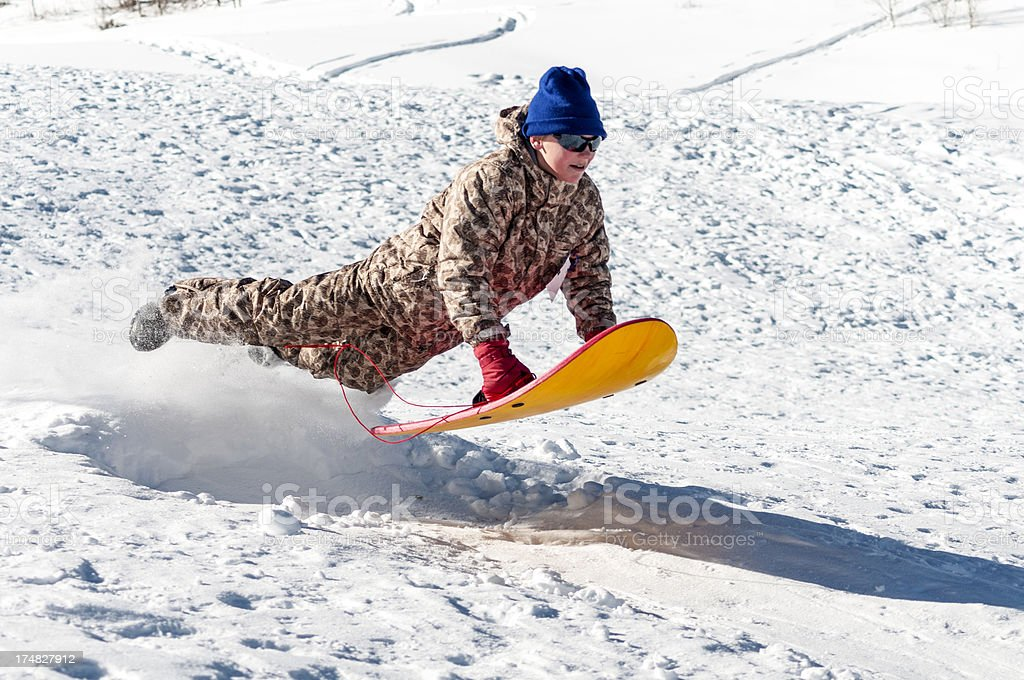 Young Boy on Sled in Winter royalty-free stock photo