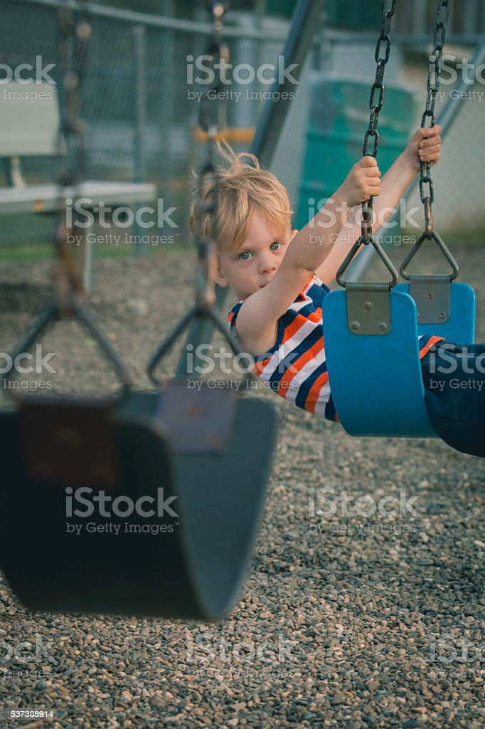 Young Boy on Swing stock photo