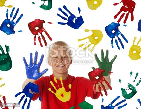 istock Young Boy Painting with his Hands 123500804