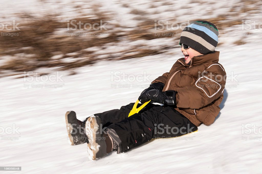 Young Boy Palying Sliding on Snow royalty-free stock photo