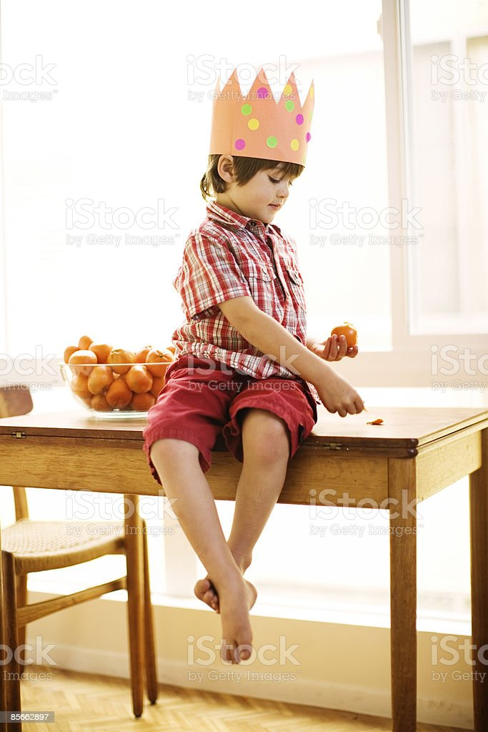 Young boy peeling an orange royalty-free stock photo