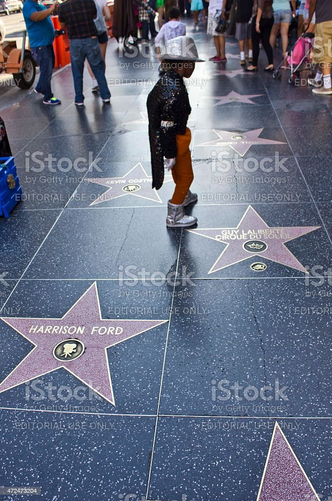 Young boy performing Michael Jackson stock photo