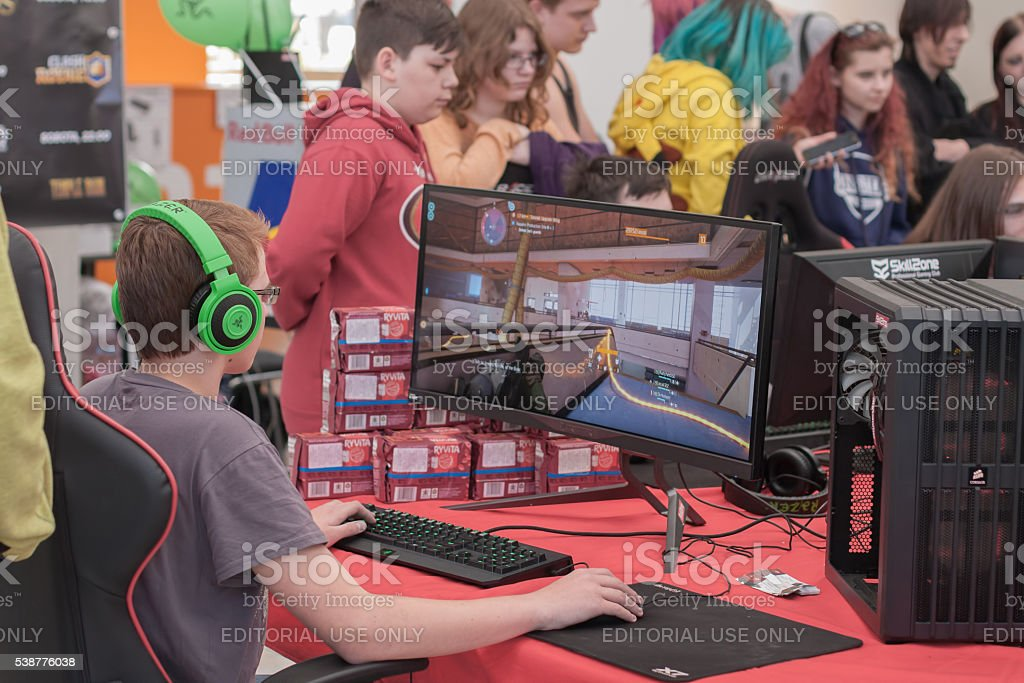 Young boy  play game on personal computer at Animefest stock photo