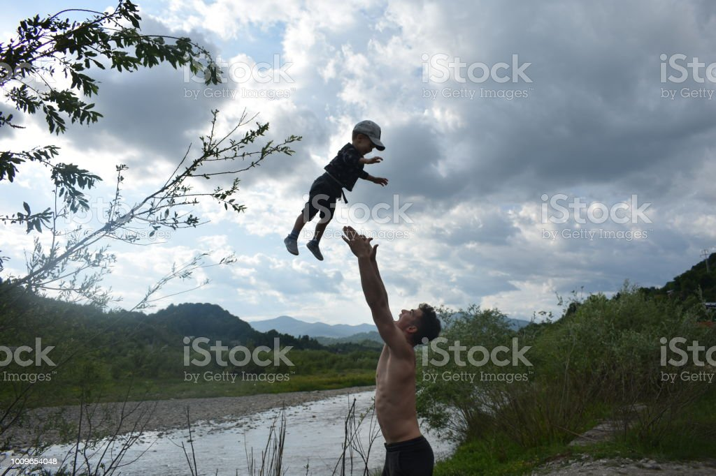 Young Boy playing and having fun with his 2 years old nephew, Brasov, Romania – zdjęcie