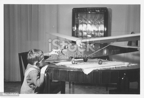 istock Young boy playing at home in 1950 952103200