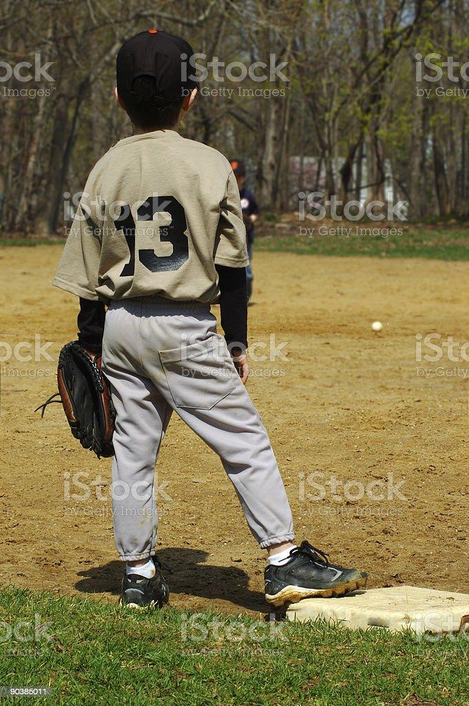 Young boy playing baseball royalty-free stock photo