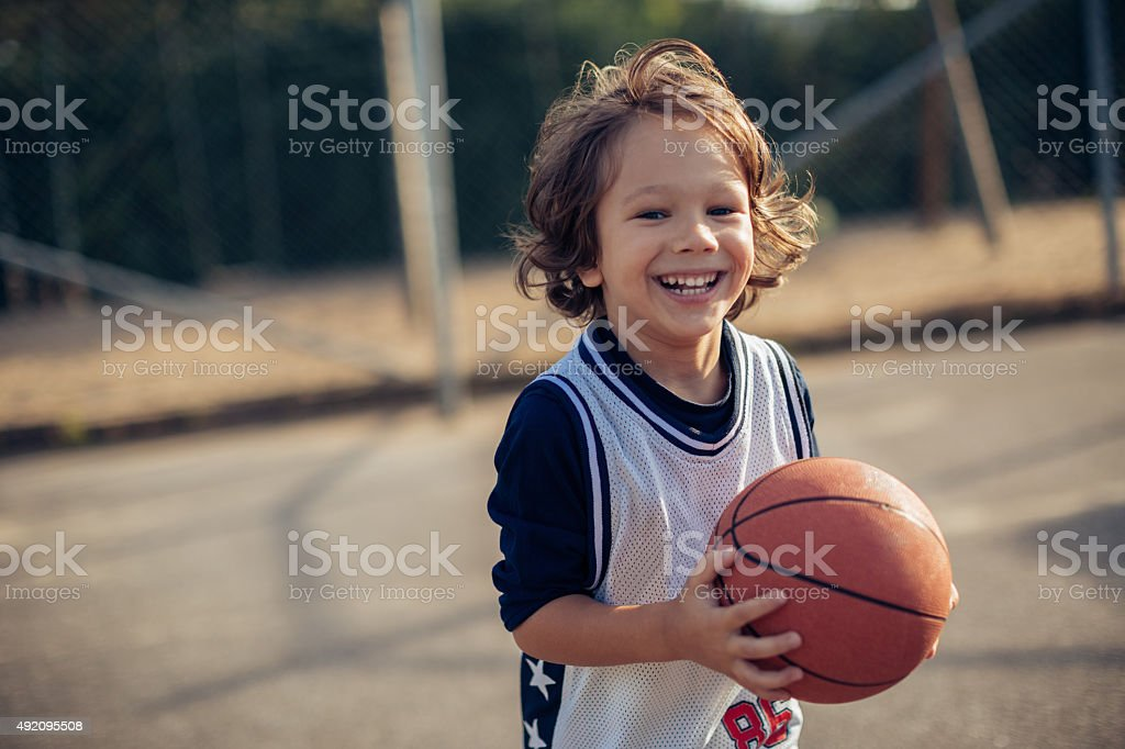 Young boy playing basketball stock photo
