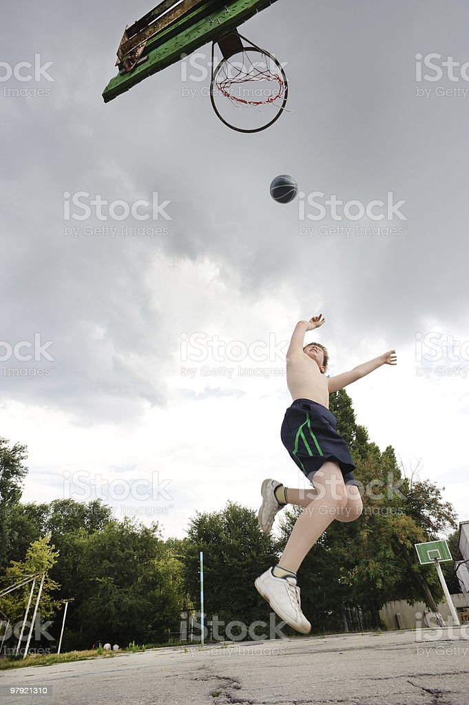 young boy playing basketball royalty-free stock photo