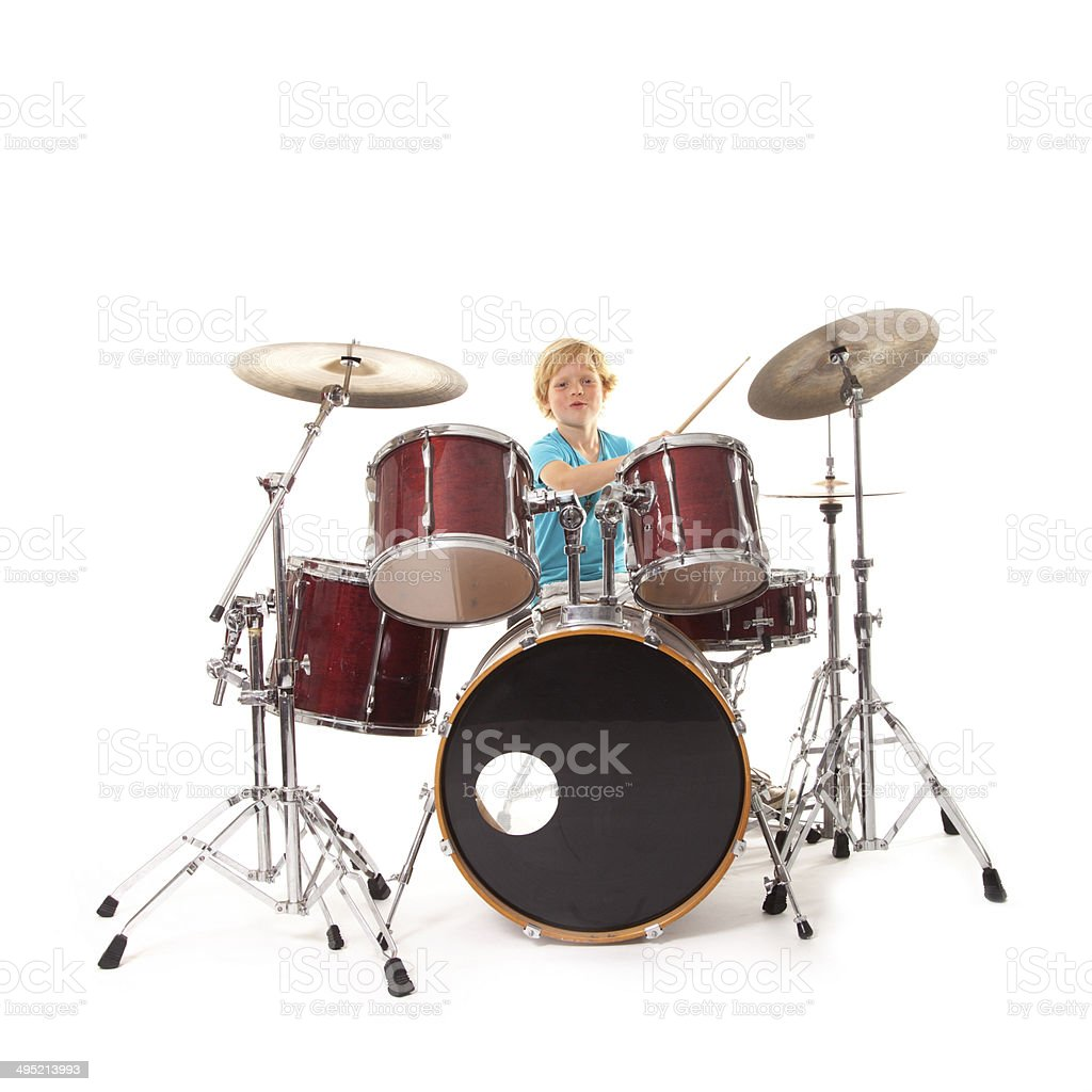 young boy playing drums stock photo