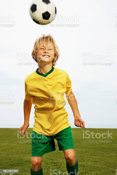 Young boy playing football against clear sky picture id182432397?b=1&k=6&m=182432397&s=612x612&h=tvicfk3befncia9i4qkgyeuidbldr5egqxno81xsnb8=