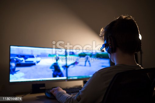 Young boy playing games on a computer at home