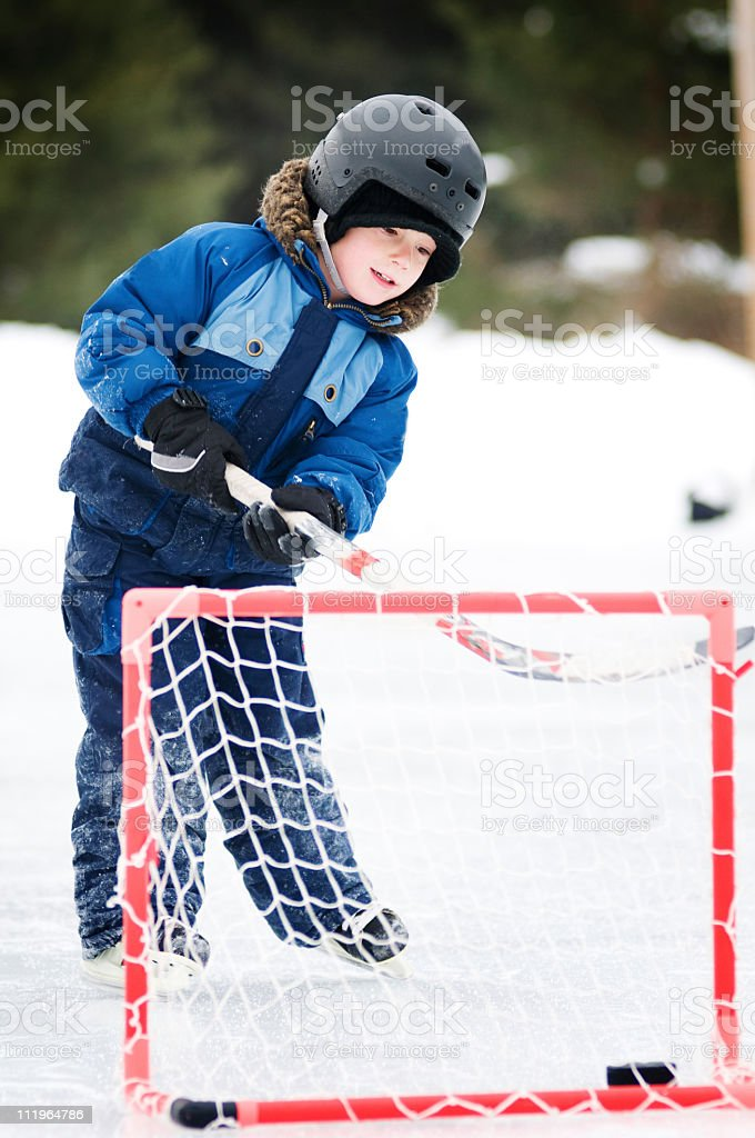 young boy playing hockey royalty-free stock photo
