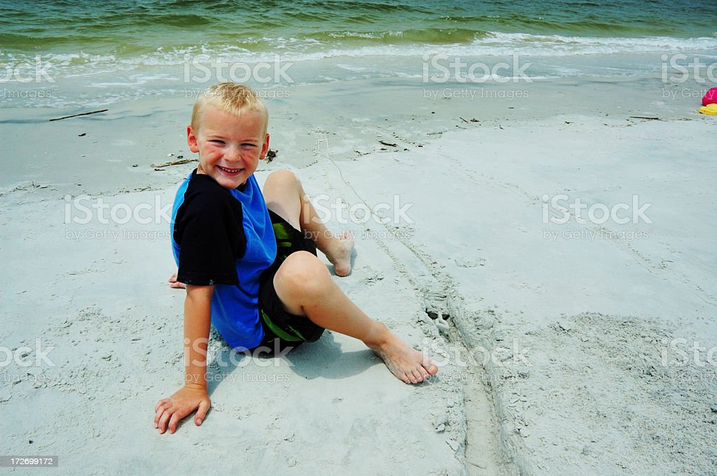 Young Boy Playing in Sand at the Amelia Island Beach stock photo