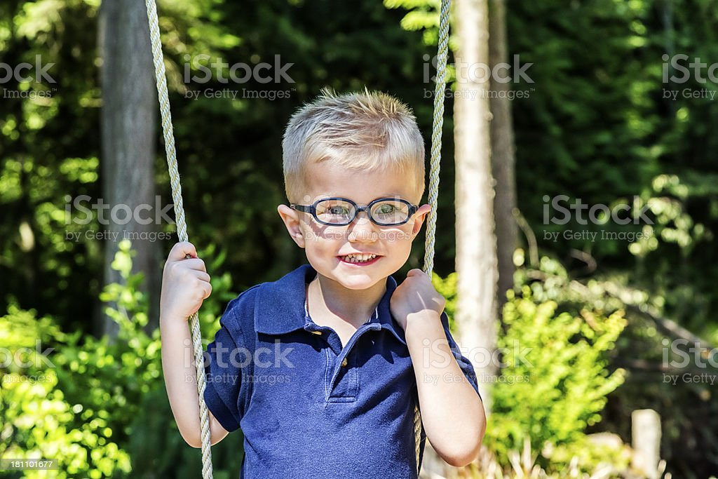 Young Boy Playing on Swing royalty-free stock photo