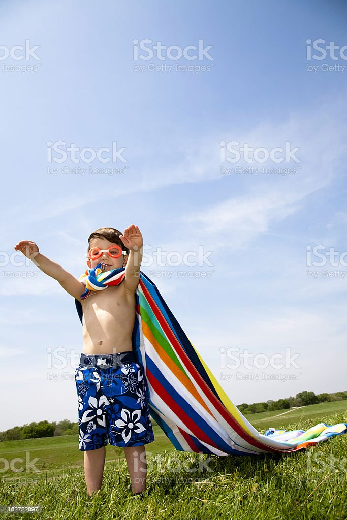 Young Boy Playing Superman with Towel and Swim Goggles royalty-free stock photo