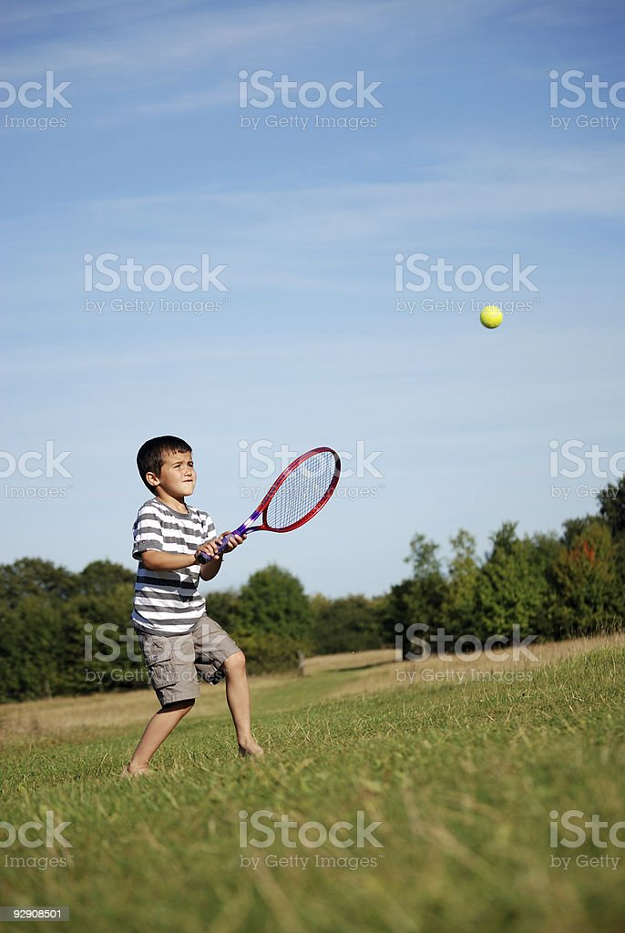 Young boy playing tennis royalty-free stock photo
