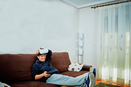istock Young boy playing video games with 3d glasses 1141187753