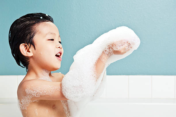 Young boy playing with bubbles stock photo