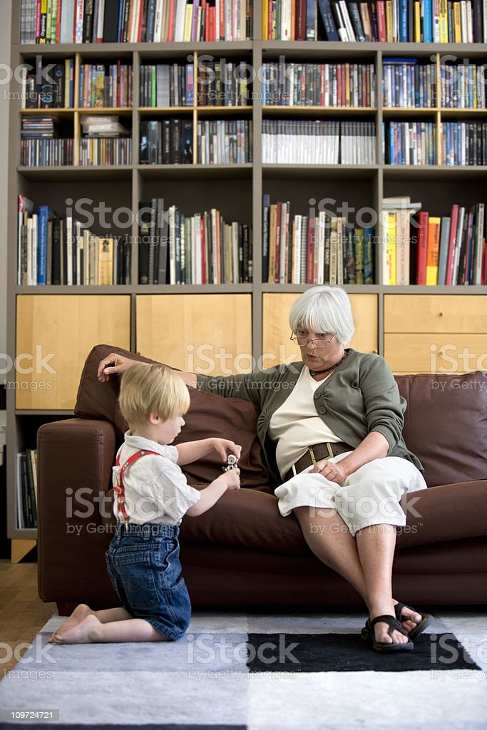 young boy playing with grandmother royalty-free stock photo