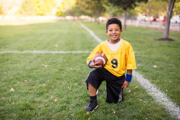A Young Boy Plays Flag Football stock photo