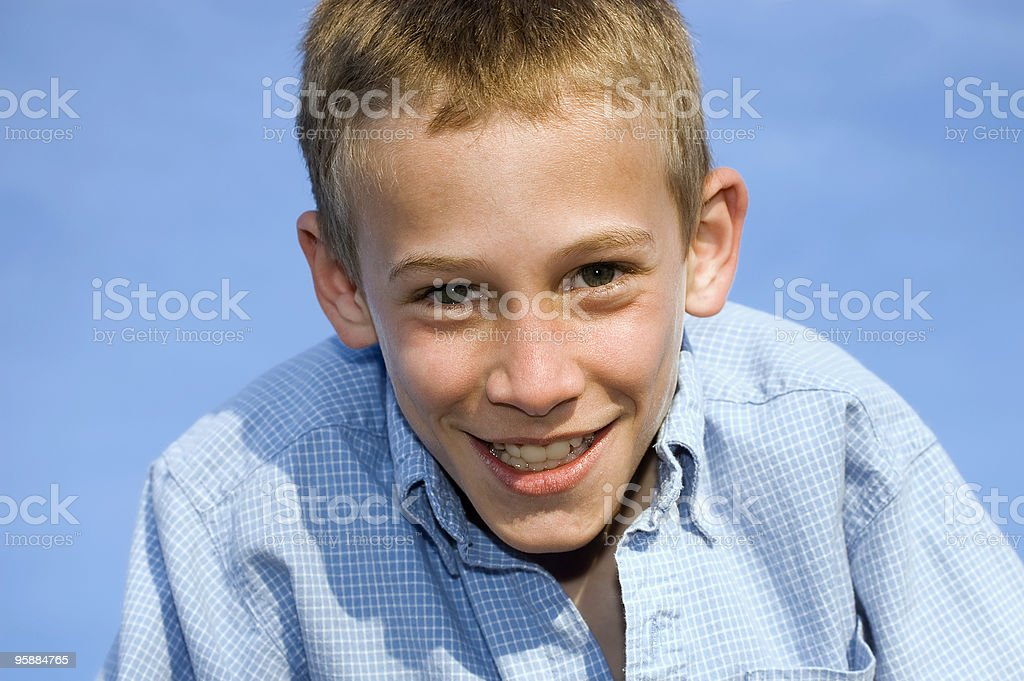Young Boy Portrait Against Blue Sky royalty-free stock photo