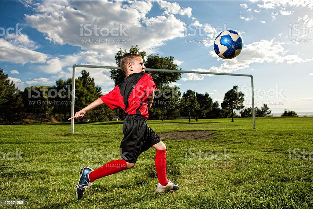 Young Boy Practicing Soccer Goal Kicks royalty-free stock photo