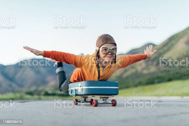 Photo of Young Boy Ready to Travel with Suitcase