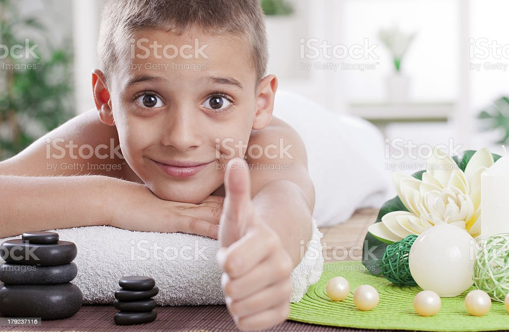 young boy ready to treatment in spa salon royalty-free stock photo