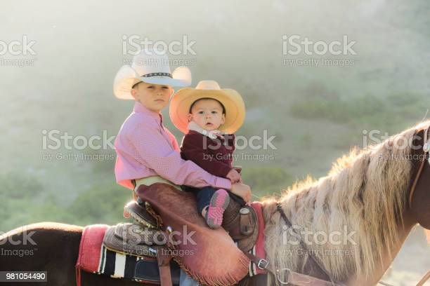 Young boy rides his horse with his baby cousin picture id981054490?b=1&k=6&m=981054490&s=612x612&h=zuqhc2qousaqxtajwih5gtbudqxktsn1ch rmjzfrc4=