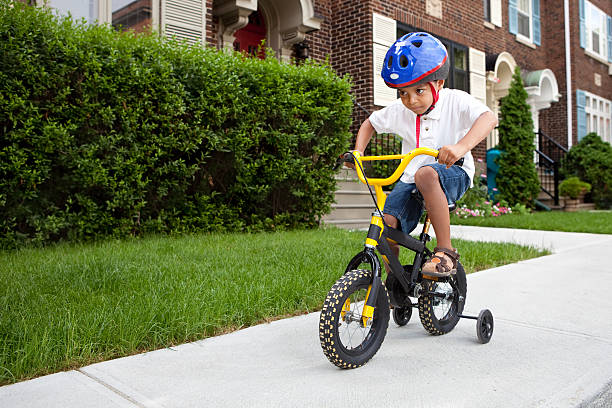 Young boy riding a bicycle stock photo