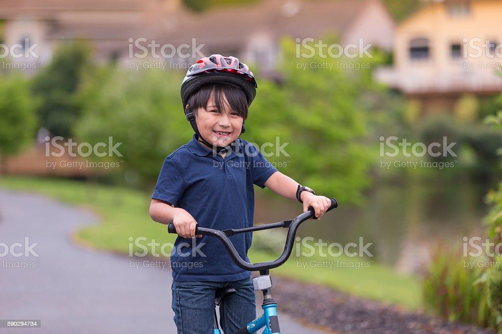 Young boy riding a bike royaltyfri bildbanksbilder