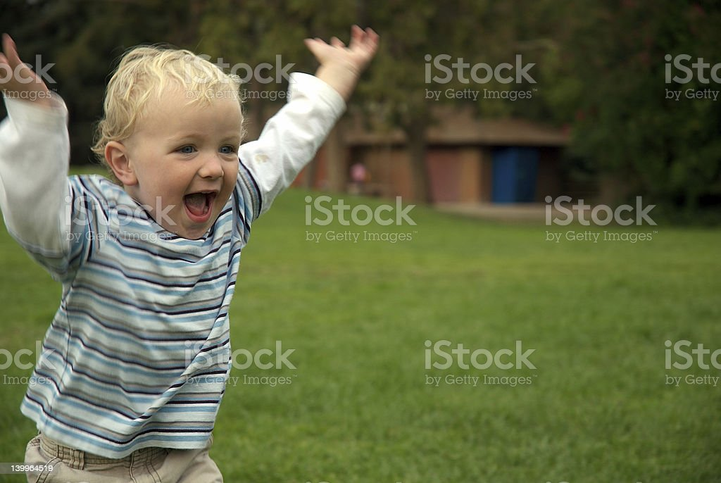 young boy running in park royalty-free stock photo