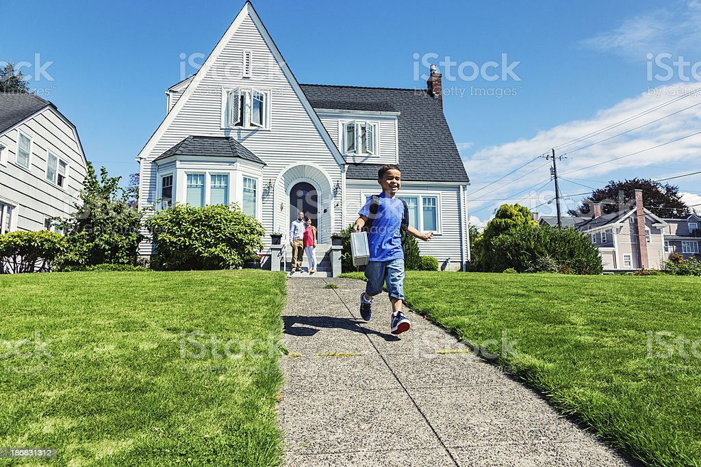 Young Boy Running Off To School stock photo