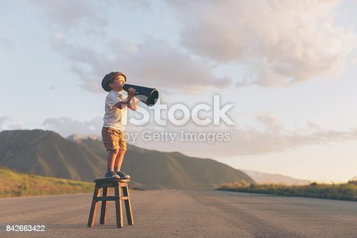 istock Young Boy Salesman Delivers Megaphone Message 842663422