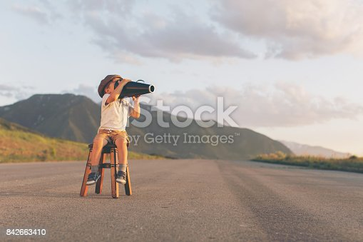 istock Young Boy Salesman Gives Megaphone Message 842663410