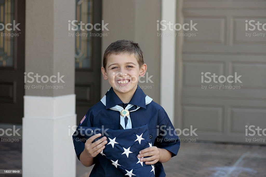 Young Boy Scout with American Flag stock photo