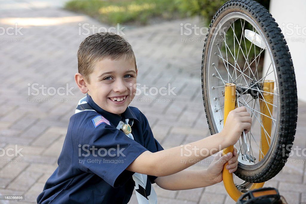 Young Boy Scout with Bicycle royalty-free stock photo