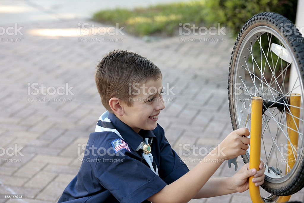 Young Boy Scout with Bicycle stock photo