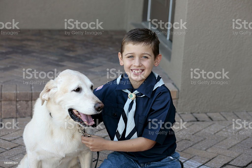 Young Boy Scout With His Dog stock photo