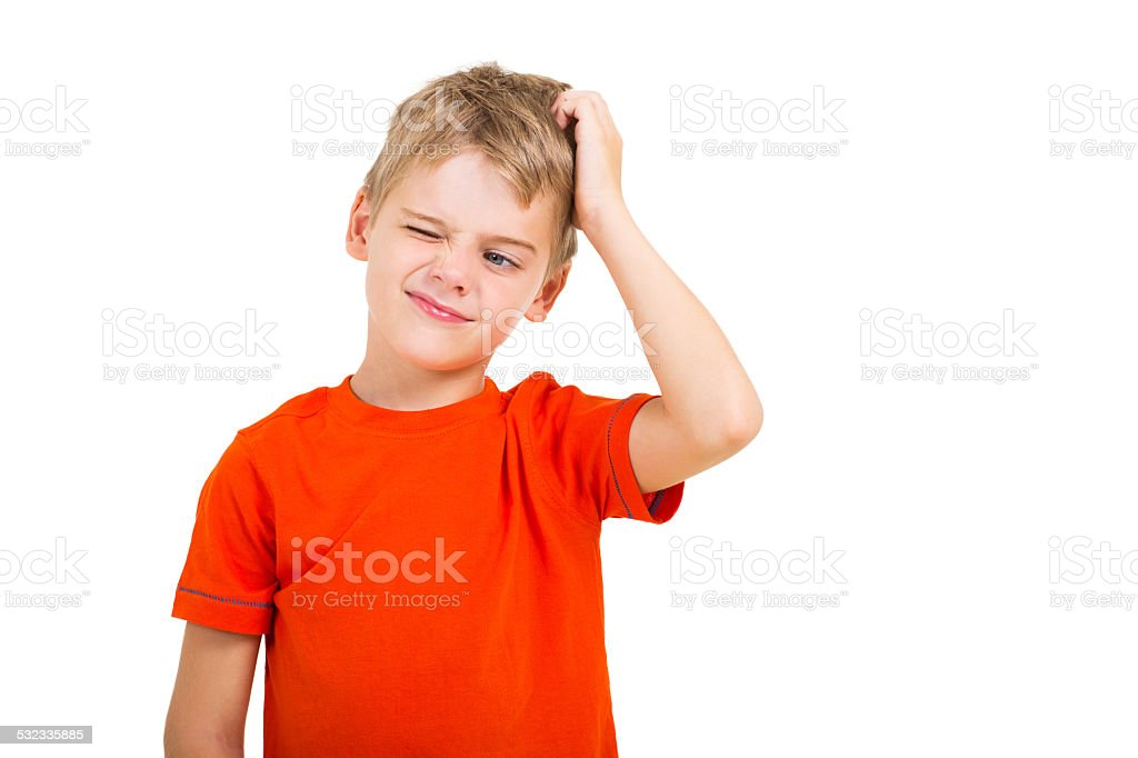 young boy scratching his head stock photo